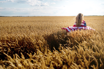 Flag cover girl in field. Image for Protecting American from Tax Hikes details